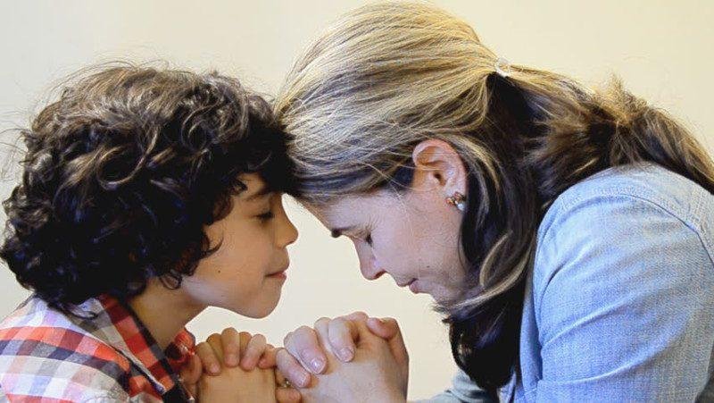 mom and son praying
