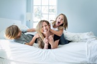 mom playing with children