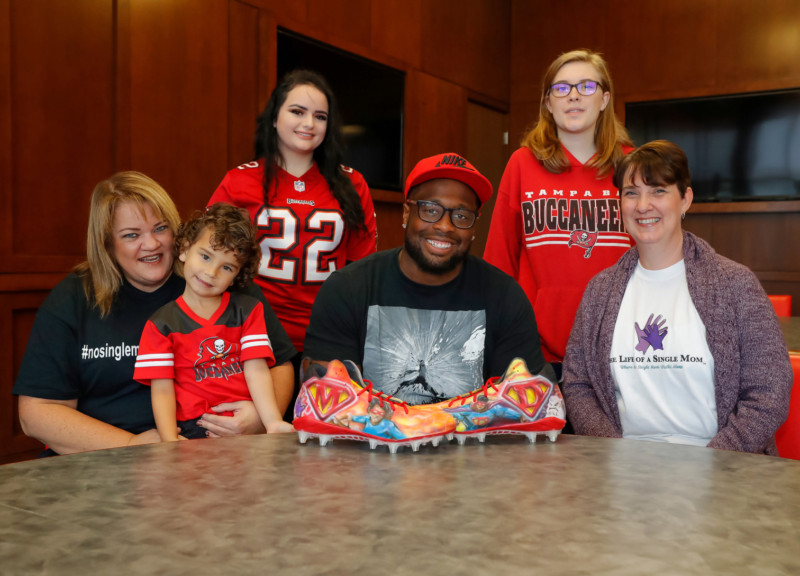 McCoy with cleats and family
