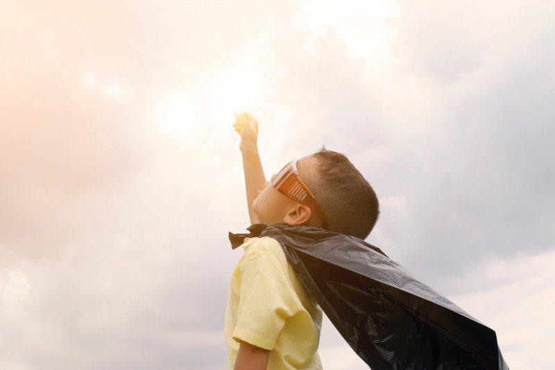 child with cape hero