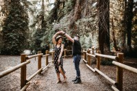A dating couple salsa dancing in the woods